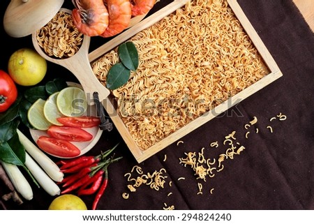 Dry instant noodle - asian ramen and shrimp ,vegetables for soup - stock photo