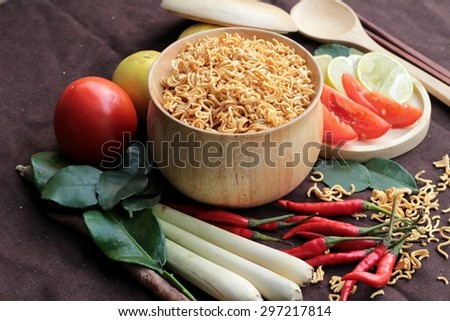 Dry instant noodle - asian ramen and vegetables for the soup - stock photo