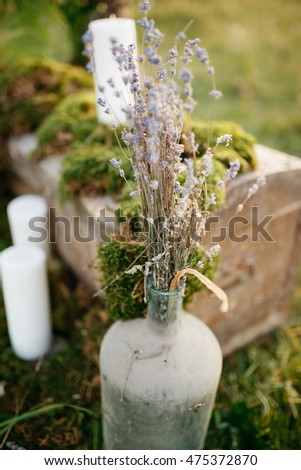 Dry lavander put in a glass bottle standing on the lawn