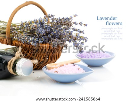 dry lavender flower in a basket with bath salt, isolated on white background - stock photo