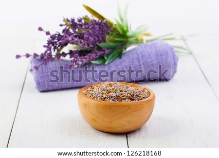 dry Lavender herbs, and flowers on the serviette, on white wooden background