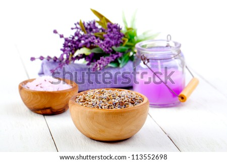 dry Lavender herbs, bath salt and candle, on white wooden table