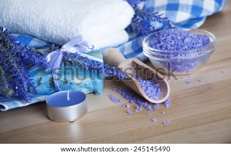 Dry lavender,natural soap,salt on a wooden board, hygiene items for bath and spa - stock photo