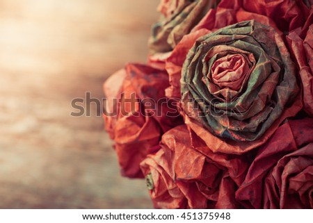 Dry leaf flowers in a bouquet, on old wooden table background, autumn themes, fall orange leaves, Abstract floral background - stock photo
