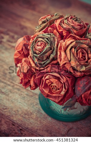 Dry leaf flowers in a bouquet, on old wooden table background, autumn themes, fall orange leaves, - stock photo