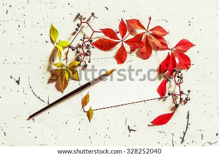 Dry leaves with blank letter and paint brush, vintage style - stock photo