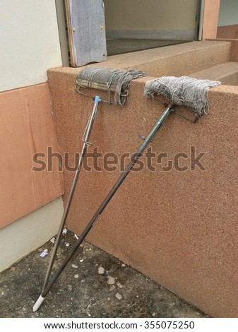 Dry Mop on concrete wall