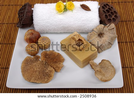 Dry mushroom, seeds, natural olive oil soap, roses, and towel