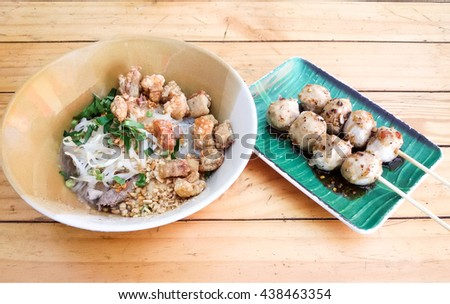 Dry Noodle with crackling and two Barbecued pork ball - stock photo