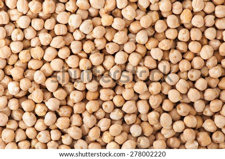 Dry organic chickpeas background. - stock photo