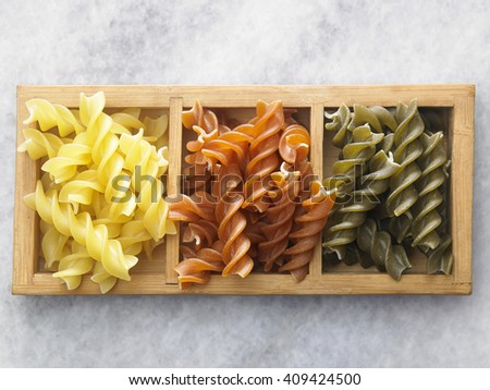 dry pasta on the marble top - stock photo