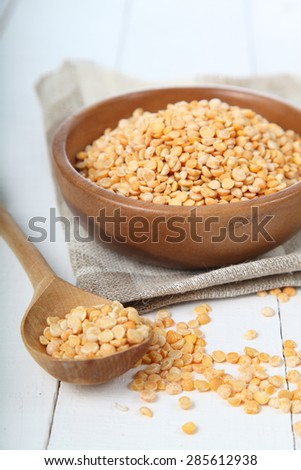 Dry peas on a wooden table