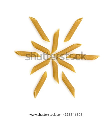 Dry penne pasta in snowflake formation isolated on white background.