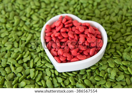 dry pet food red and green with heart shape cup  , love pet concept - stock photo