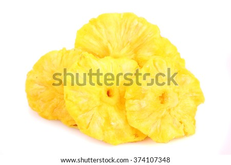 dry pineapple heap against white background