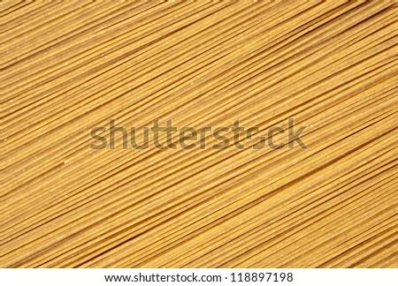 Dry raw integral spaghetti background - stock photo