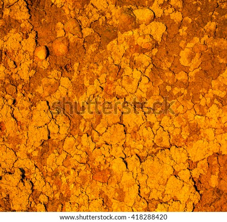 Dry red clay soil texture - stock photo