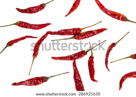 Dry red hot thai chili pepper on white background - stock photo