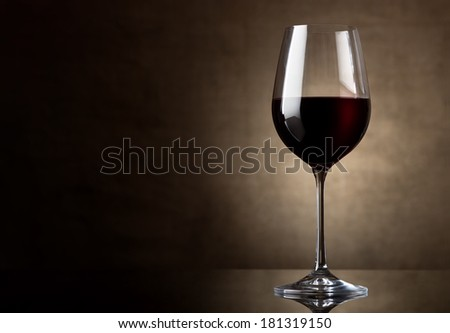 Dry red wine in wineglass on a canvas