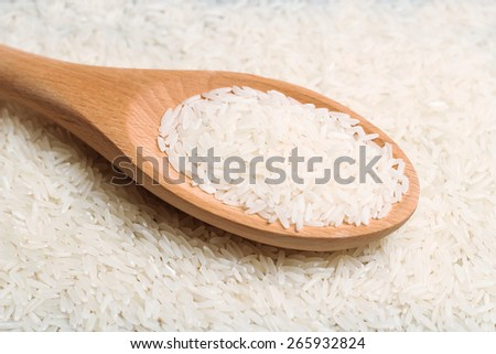 Dry rice in a spoon. Selective focus, top view