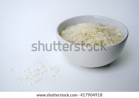 Dry rice in the bowl - stock photo