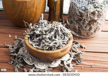 Dry sage tea on a wooden background  - stock photo