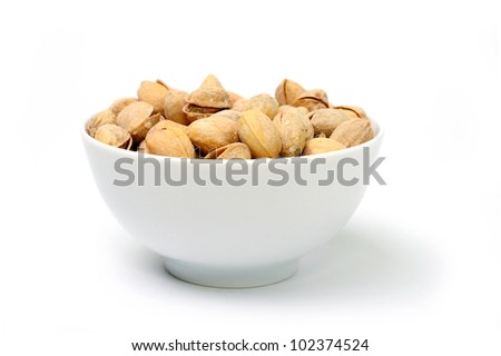 Dry salted pistachio fruit in bowl on white background - stock photo