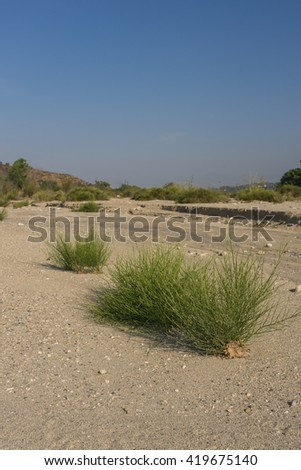Dry sandy bed of Santa Clara River in drought heat of southern California. - stock photo