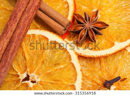 Dry slices of orange, cinnamon, cloves and cardamom - stock photo