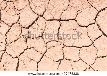 dry soil cracked earth texture - stock photo