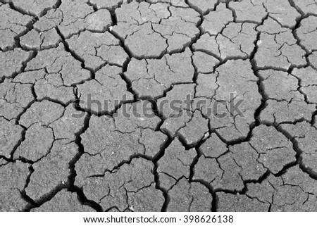 Dry soil texture of a barren land White and black - stock photo