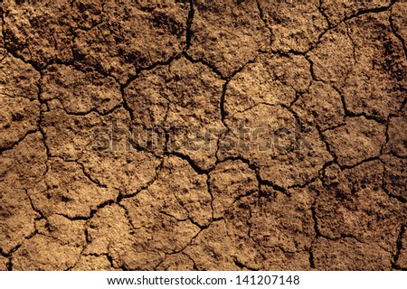 Dry soil texture on the ground - stock photo