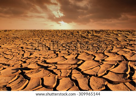 Dry soil texture on the ground with sky background - stock photo