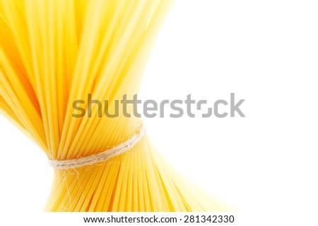Dry spaghetti isolated on white background - stock photo