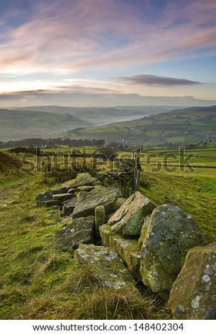 dry stone wall in yorkshire farmland - stock photo