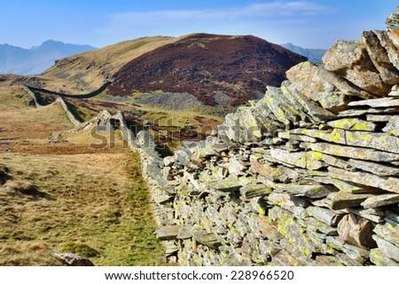 Dry Stone Wall leading towards Lingmoor Fell - stock photo