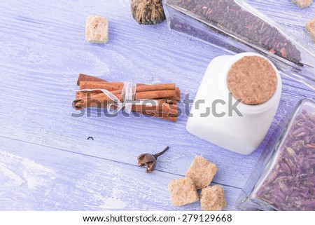 dry tea leaves cinnamon and on wooden background - stock photo