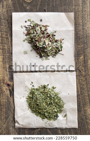 Dry  tea on a wooden table, from above - stock photo