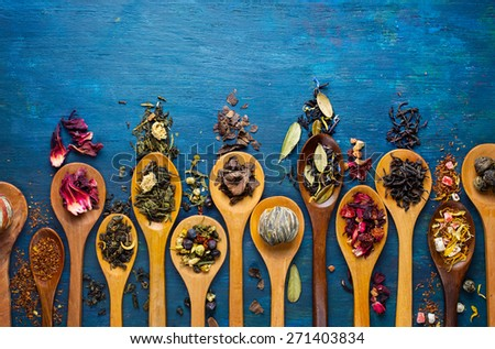 Dry tea with in wooden spoons. Top view - stock photo