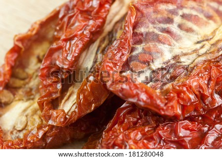 dry tomatoes on wooden background