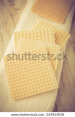 Dry wafers on white wooden table. studio shot