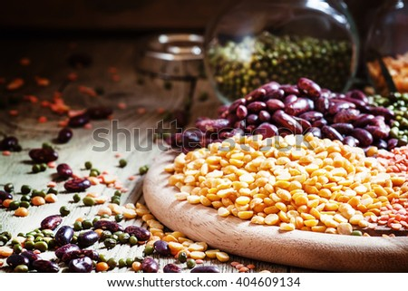 Dry yellow peas, bean mix, vintage wooden background, selective focus