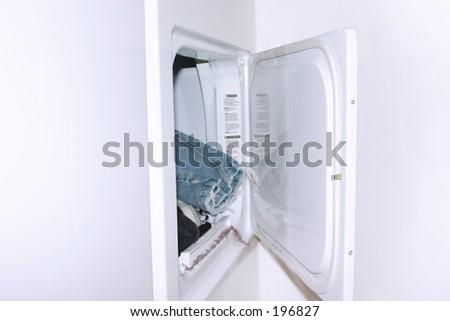 Dryer in laundry room - stock photo