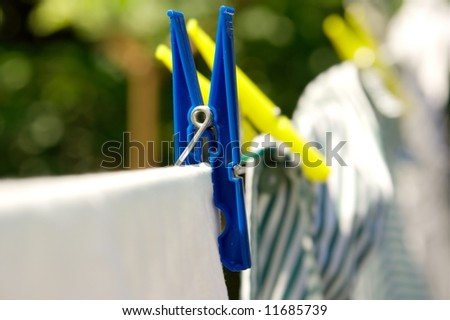 Drying clothes hanging on the rope, shallow dof - stock photo