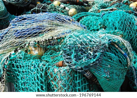 Drying fishing nets in Le Guilvinec harbor, France. Le Guilvinec is the largest harbor for fishing in France.  - stock photo