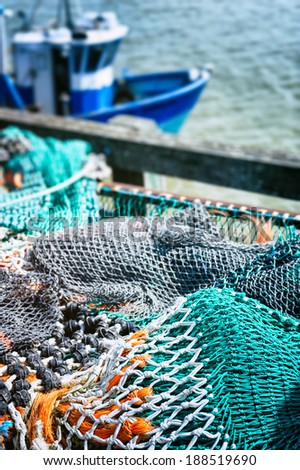 Drying fishing nets in port  - stock photo