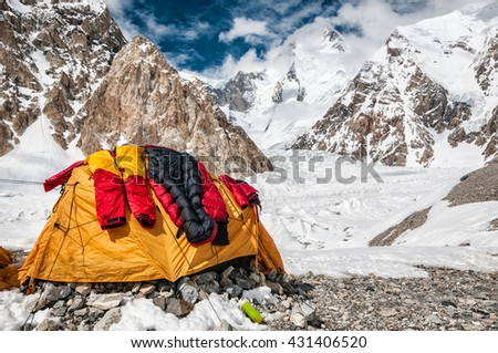 Drying of high altitude down suit and sleeping bag in Base Camp. Gasherbrum I in the background.