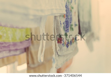 Drying towels and clothes on the home balcony - stock photo
