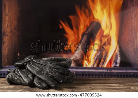 drying wet umbrella gloves hat cap at fireplace in fall autumn winter