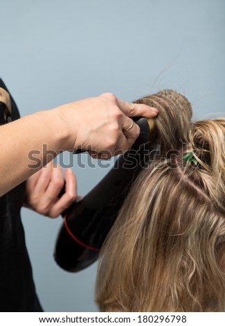 drying with a hair dryer in the barbershop - stock photo